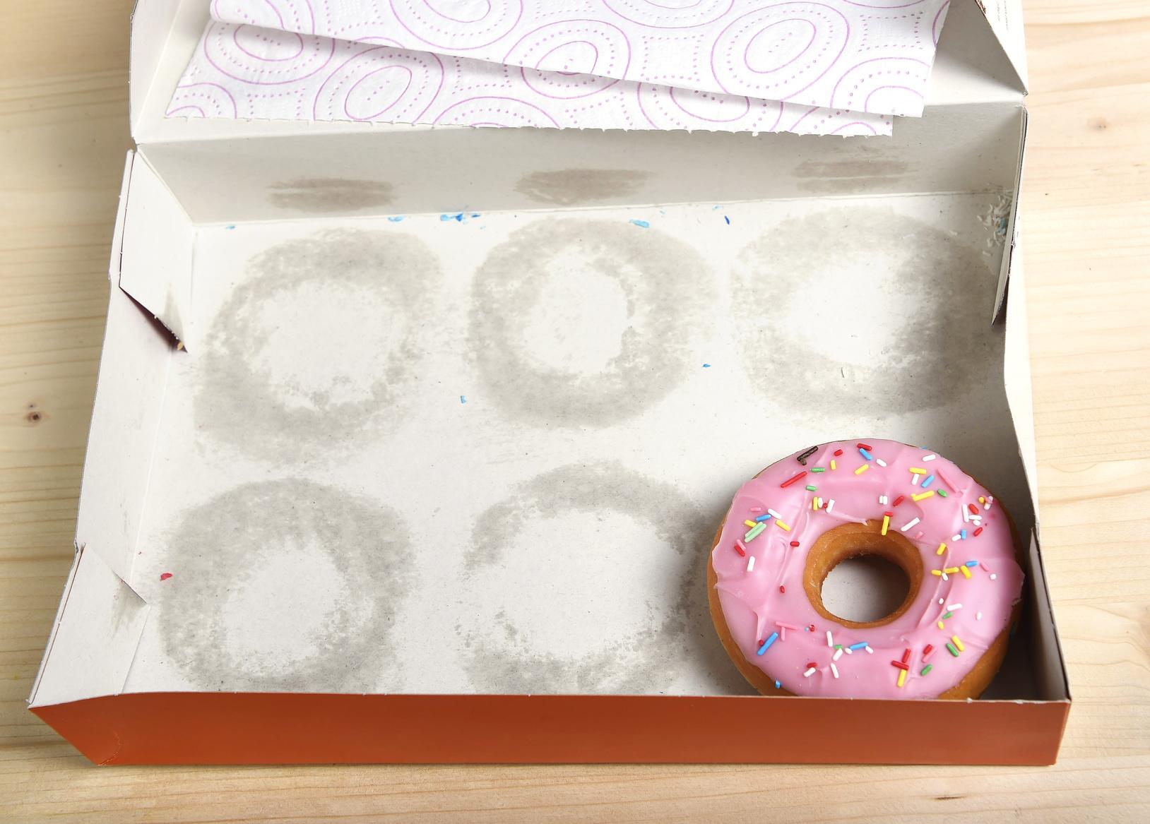 fettige und überzuckerte Donuts